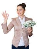 Gelukkige bedrijfsvrouw met een bundel van dollars stock afbeelding