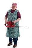 Gelukkige bejaarde die een elektrische tuinzaag houdt Royalty-vrije Stock Afbeelding