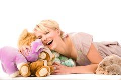 Gelukkige blonde met speelgoed Stock Foto