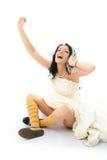 Gelukkige bruid die aan de muziek luistert Stock Foto's