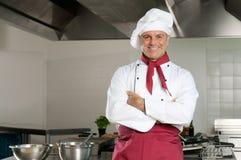 Gelukkige chef-kok op het werk Stock Foto