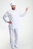 Gelukkige chef-kokkok die welkom gebaar tonen Royalty-vrije Stock Foto's