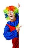Gelukkige clown die de lege raad houdt Royalty-vrije Stock Afbeeldingen
