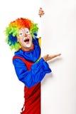 Gelukkige clown die de lege raad houdt Stock Afbeelding