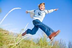 Gelukkige dansende jongen Stock Afbeeldingen