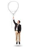 Gelukkige de ballontekening van de mensenholding Stock Fotografie