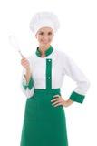 Gelukkige die vrouw in chef-kok eenvormig met bloemkroon op wit wordt geïsoleerd stock foto