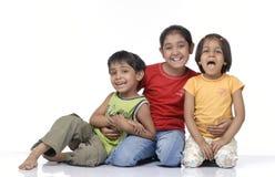Gelukkige drie kinderen Royalty-vrije Stock Afbeeldingen