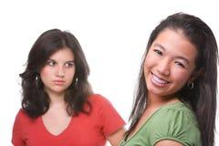 Gelukkige en ongelukkige vrouwelijke tieners Stock Afbeelding