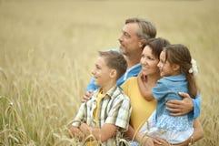 Gelukkige familie bij gebied Royalty-vrije Stock Afbeeldingen