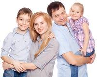 Gelukkige familie bij wit royalty-vrije stock foto