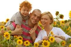 Gelukkige familie die pret heeft Stock Afbeeldingen