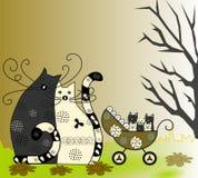 Gelukkige familie, kat, kat en katjes in een rolstoel Stock Fotografie