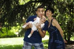 Gelukkige familie met baby Royalty-vrije Stock Afbeeldingen