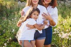 Gelukkige familie, moeder met dochters Stock Afbeelding