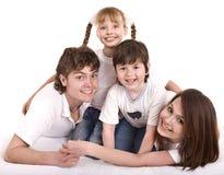 Gelukkige familie: moeder, vader, dochter, zoon. Royalty-vrije Stock Afbeeldingen