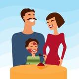Gelukkige familie, moedervader en zoon het eten Royalty-vrije Stock Foto's