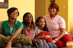 Gelukkige familie thuis Stock Foto's