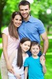 Gelukkige familie van vier Stock Foto
