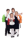 Gelukkige geïsoleerde basisschooljonge geitjes - Stock Foto