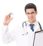 Gelukkige geïsoleerdeo arts met pil, stock foto's