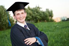 Gelukkige gediplomeerde student royalty-vrije stock foto's