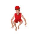 Gelukkige gekke springende jongen stock afbeeldingen