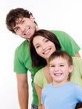 Gelukkige gezichten van een jonge familie Stock Foto