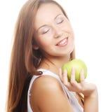 Gelukkige glimlachende die vrouw met appel, op wit wordt geïsoleerd Royalty-vrije Stock Afbeeldingen