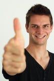 Gelukkige glimlachende mens die twee duimen omhoog doet Stock Fotografie