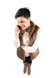 Gelukkige glimlachende vrouw op mobiele cellphone Royalty-vrije Stock Afbeeldingen