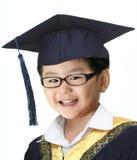 Gelukkige graduatiejongen Stock Foto