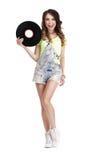 Gelukkige Grappige Vrouw die met Vinylverslag haar Li likken stock foto's