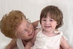 Gelukkige Grootmoeder en Kleindochter stock afbeelding