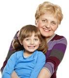 Gelukkige grootmoeder en kleindochter Stock Foto's