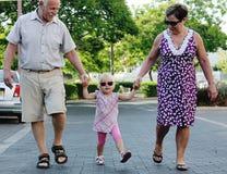 Gelukkige Grootouders met Kleinkind stock foto's