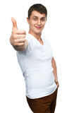 Gelukkige het glimlachen kerel die duim op handteken tonen Royalty-vrije Stock Fotografie