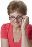 Gelukkige hogere vrouw met glazen royalty-vrije stock foto