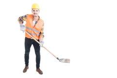 Gelukkige ingenieur die een schop houden als het graven concept Stock Foto's