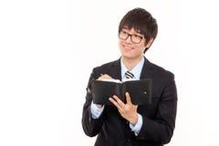 Gelukkige jonge Aziatische bedrijfsmens Royalty-vrije Stock Foto's