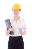 Gelukkige jonge bedrijfs geïsoleerde vrouwenarchitect in bouwershelm Stock Afbeeldingen