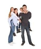 Gelukkige jonge familie het besteden tijd samen Stock Afbeelding