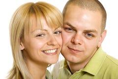 Gelukkige jonge man en vrouw die zich verenigen Stock Fotografie