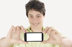 Gelukkige jonge mens die een selfiefoto met zijn slimme telefoon nemen Royalty-vrije Stock Afbeelding
