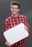 Gelukkige jonge mens die naar een baan met leeg paneel zoeken Stock Fotografie