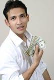 Gelukkige jonge mens met geld Stock Afbeelding