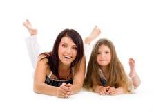 Gelukkige jonge moeder en dochter Stock Foto's