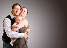 Gelukkige jonge ouders met babydochter Royalty-vrije Stock Foto's