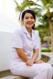 Gelukkige jonge verpleegster Stock Foto