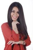 Gelukkige jonge vrouw die over witte achtergrond glimlachen Stock Foto